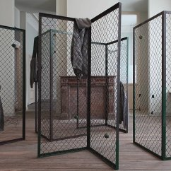 History in Imaginary Time, 2012 metal fences, tennis balls, hoodies, cable ties, paint 200 x 80 x 80 cm each